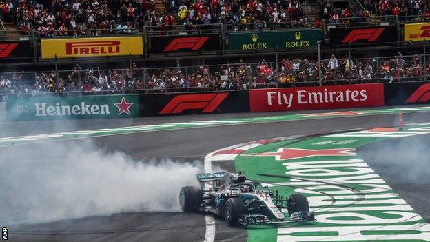 Lewis Hamilton celebrates clinching his fifth world title by performing a series of 'donuts' on the Hermanos Rodriguez circuit