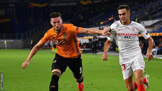 Matt Doherty playing for Wolves against Sevilla's Sergio Reguilon
