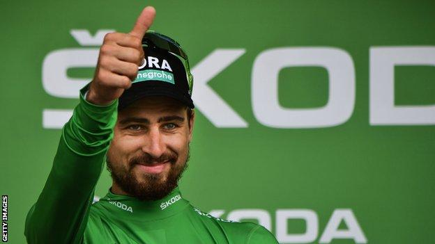 Peter Sagan gives a thumbs up on the podium to celebrate winning stage 13