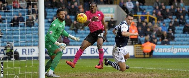Souleymane Coulibaly (centre) in action for Peterborough against Millwall