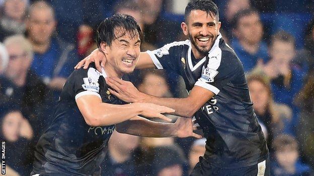 Shinji Okazaki and Riyad Mahrez celebrate Leicester's third goal
