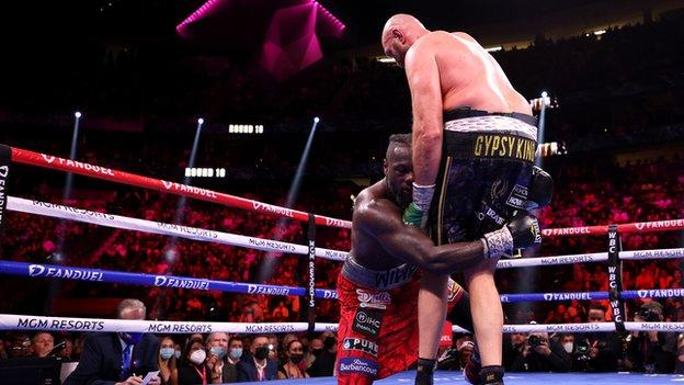 Tyson Fury knocks down Deontay Wilder for a second time