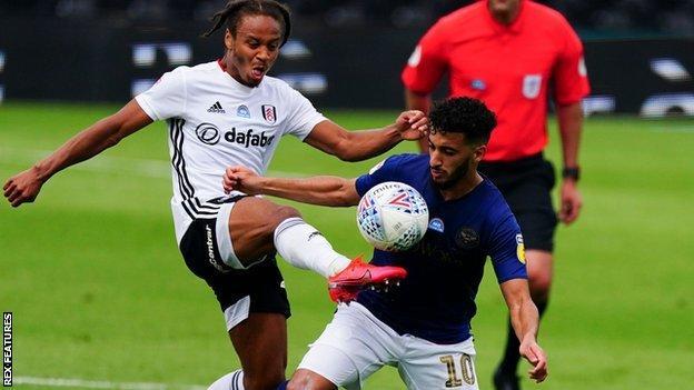 Bobby De Cordova Reid of Fulham battles with Said Benrahma of Brentford