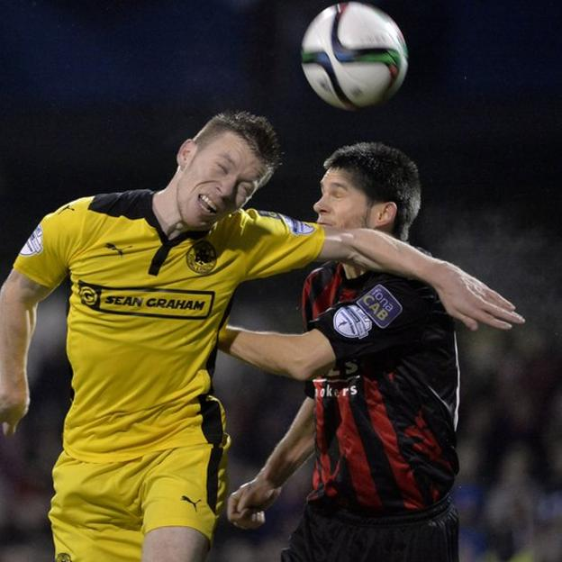 Stephen Garrett of Cliftonville and Crusaders defender Craig McClean compete for a high ball during the clash between the top two teams in the Irish Premiership