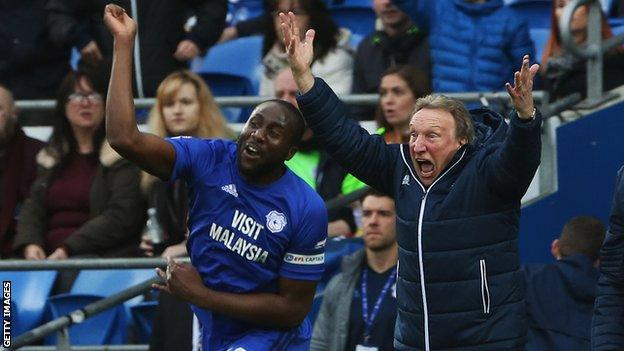 Cardiff defender Sol Bamba and manager Neil Warnock celebrate sealing promotion to the Premier League last season