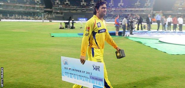 MS Dhoni walks off the field with a cheque for 75m rupees