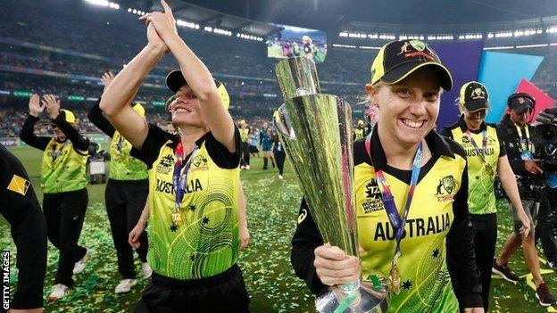 Alyssa Healy and the Australia team celebrate with the Women's T20 World Cup trophy