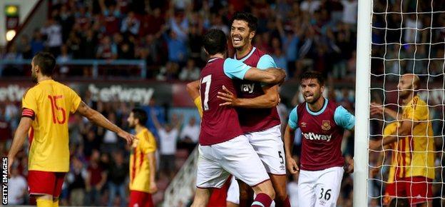 James Tomkins celebrates West Ham's winner in the first leg against Birkirkara