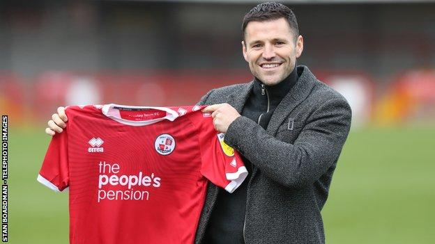 Mark Wright holds up Crawley Town shirt