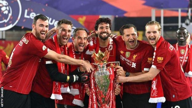 Andy Lonergan and Liverpool's goalkeepers and staff lift the Premier League trophy