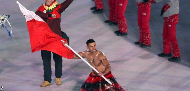 A shirtless Taufatofua braves the freezing Pyeonghchang temperatures to carry his nation's flag at last Friday's opening ceremony