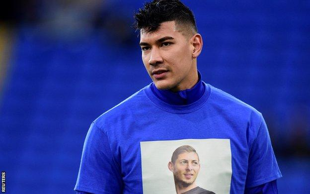 Cardiff goalkeeper Neil Etheridge displays the t-shirt showing Sala's face that players wore to warm up