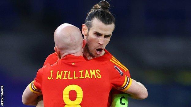 Gareth Bale celebrates with Jonny Williams