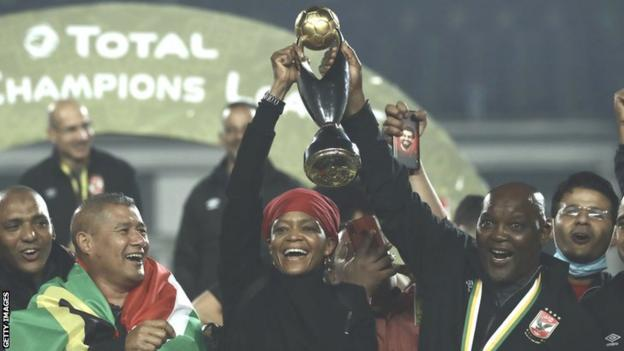 South African coach Pitso Mosimane (right) with the African Champions League trophy after winning with Al Ahly