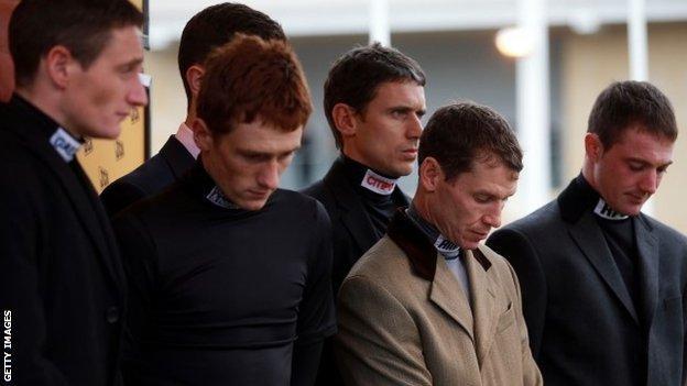 Jockeys at Cheltenham observe a minute's silence