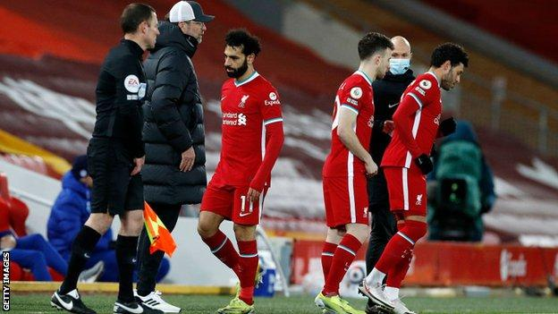 Mohamed Salah walks off the pitch as he is substituted against Chelsea
