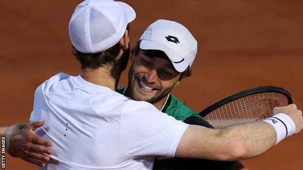 Liam Broady and Andy Murray celebrate winning their Italian Open doubles match