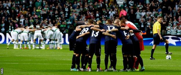 Celtic and Malmo go into their huddles before kick-off