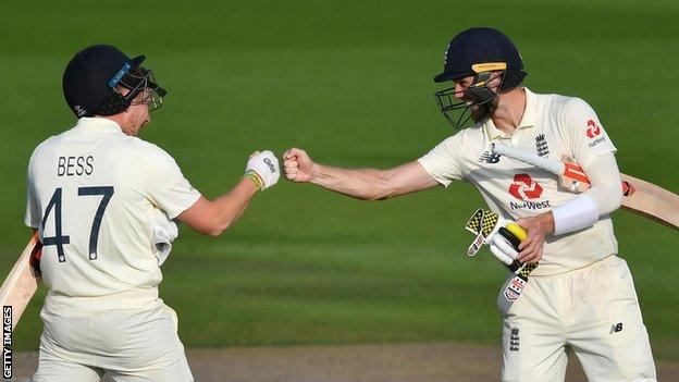 Dom Bess and Chris Woakes celebrate England's three-wicket win in the first Test