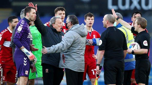 Neil Warnock leads Middlesbrough's protests after Swansea's contentious late penalty