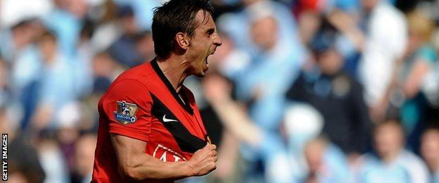 Gary Neville playing for Manchester United against Manchester City in 2010