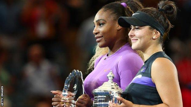 Serena Williams and Bianca Andreescu hold their US Open prizes