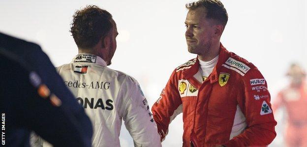 Sebastian Vettel shakes Lewis Hamilton's hand after the Singapore Grand Prix