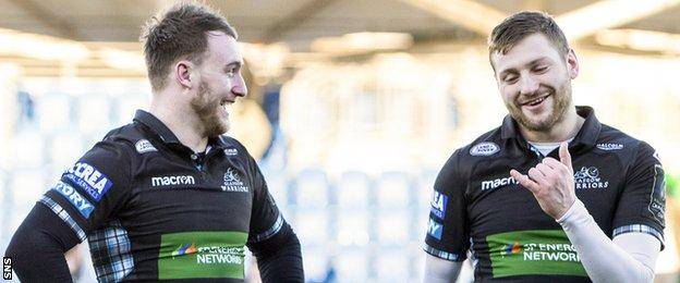 Stuart Hogg and Finn Russell celebrate a Glasgow victory