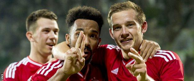Shay Logan (left) and Peter Pawlett celebrate after combining for Aberdeen's second goal