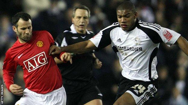 Manchester United's Ryan Giggs is tackled by Miles Addison of Derby