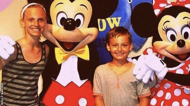 Molly Bartrip and her brother Joseph with Mickey and Minnie Mouse