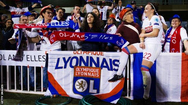 Lucy Bronze celebrating with Olympique Lyon supporters