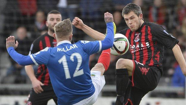 Kirk Millar and Craig McClean vie for possession during the top-of-the-table clash at Seaview