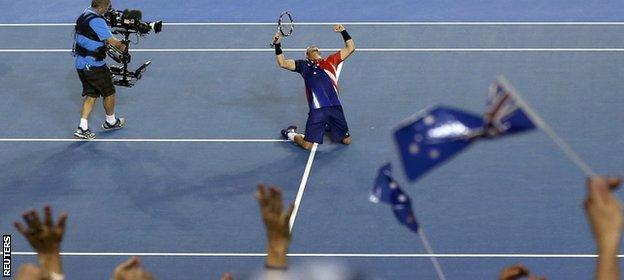 Hewitt falls to his knees after his win