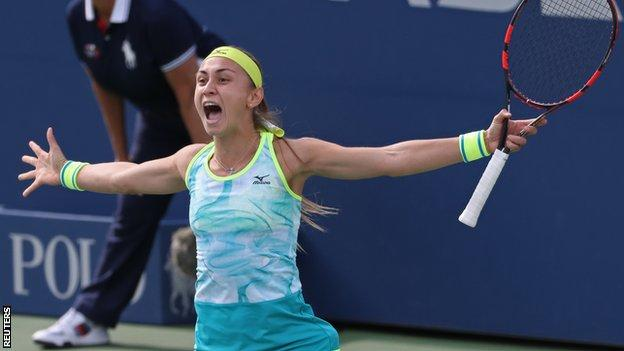 Aleksandra Krunic celebrates beating Johanna Konta at the US Open