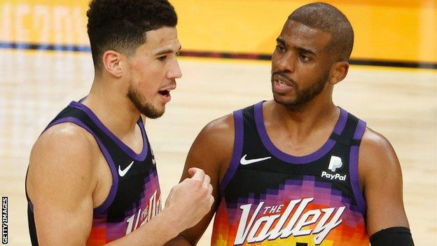 Devin Booker (left) and Chris Paul (right)