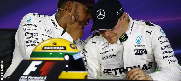 Lewis Hamilton and Valtteri Bottas share a word in the press conference