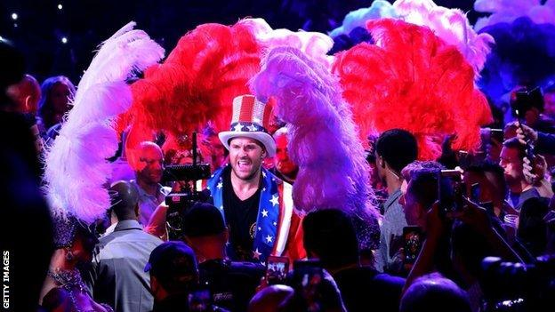 Fury walked to the ring in US colours after taking off an all-black robe