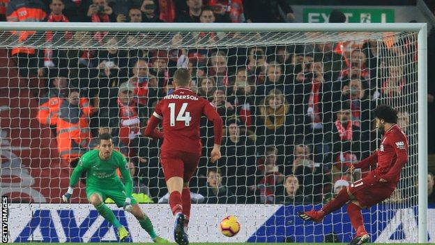 Liverpool's Mohamed Salah scores a penalty against Newcastle