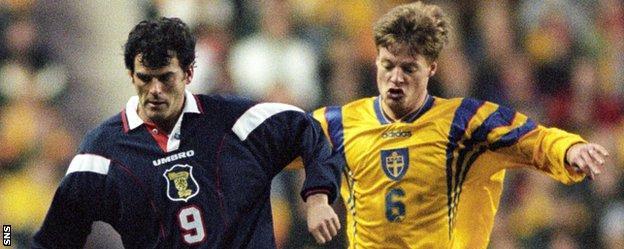 Darren Jackson in action for Scotland against Sweden