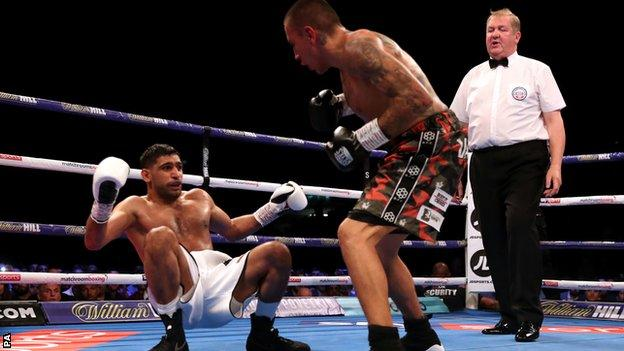 Khan quickly got back to his feet after being put down in round two