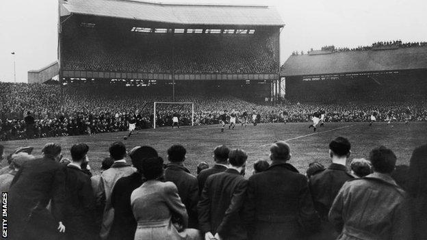 A crowd of around 100,000 watching Chelsea play Moscow Dynamo at Stamford Bridge in the first game of the Russians' tour of Britain