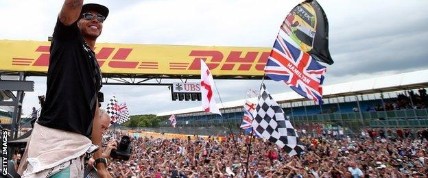 Lewis Hamilton waves to the fans after winning the British Grand Prix