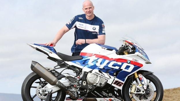 Ryan Farquhar with the Tyco BMW Superbike he will ride at the Isle of Man TT