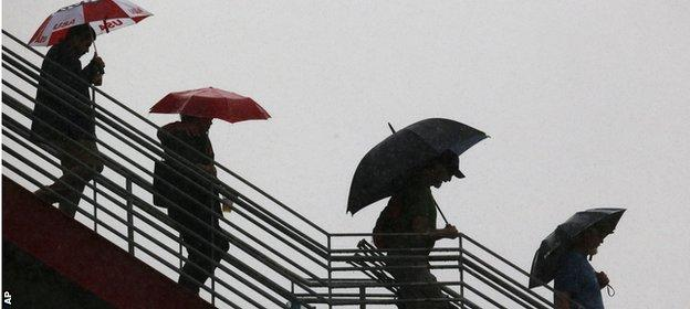 Fans try to keep dry during last year's rain-sodden US Grand Prix