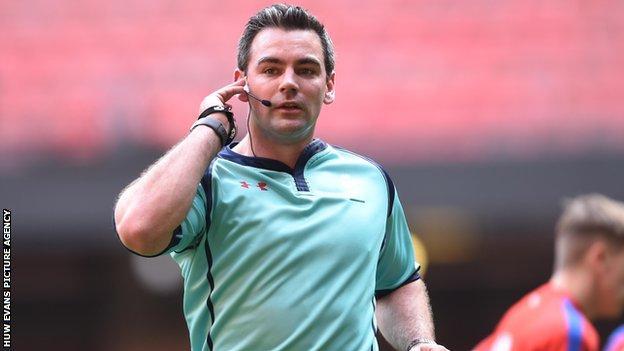 Adam Hughes refereeing