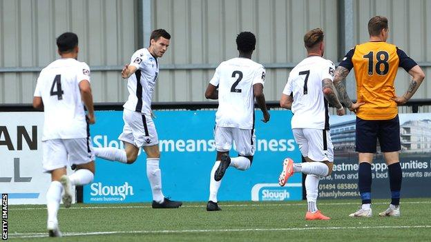 Dartford players celebrate a goal
