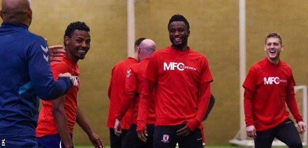 John Mikel Obi laughs with Middlesbrough team-mates and Club Together refugee players