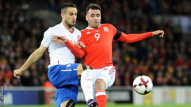 Wales forward Hal Robson-Kanu battles for the ball with Nikola Maksimovic of Serbia
