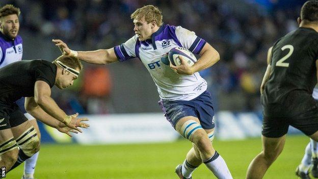 Jonny Gray carries for Scotland against New Zealand